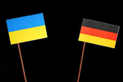 Ukraine flag with German flag on black stock image