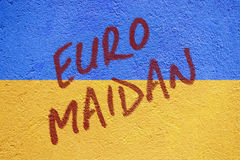 Ukraine flag painted on old concrete wall with EURO MAIDAN inscr Stock Photography