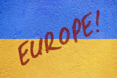 Ukraine flag painted on old concrete wall with EUROPE inscriptio Royalty Free Stock Photo