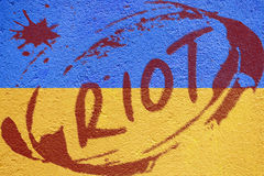Ukraine flag painted on old concrete wall with FREEDOM inscripti Stock Photo