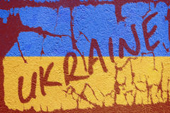 Ukraine flag painted on old concrete wall with UKRAINE inscripti Royalty Free Stock Photography