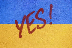 Ukraine flag painted on old concrete wall with YES inscription Royalty Free Stock Photography