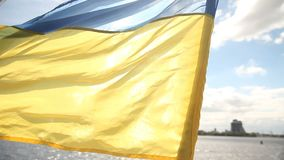 Ukraine flag on yacht. Fluttering in the wind. Yacht is sailing in the Dnieper, Ukraine stock video