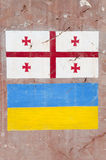 Ukraine and Georgian flag drawing on the stone Stock Photos