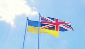 Ukraine and Great Britain, flags waving against blue sky. Two flags waving against blue sky. 3d image Stock Image