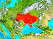 Ukraine in red on Earth Royalty Free Stock Photos