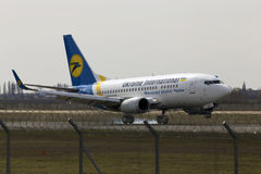 Ukraine International Airlines Boeing 737-500 aircraft landing on the runway Stock Photo