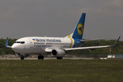 Ukraine International Airlines Boeing 737-500 aircraft preparing for take-off from the runway Royalty Free Stock Photo