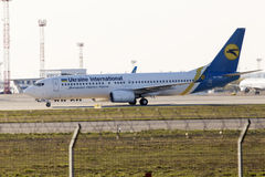Ukraine International Airlines Boeing 737-800 aircraft running to the parking Stock Photography