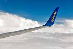 UIA Boeing aircraft wing flying at high altitude, Ukraine. Stock Photo