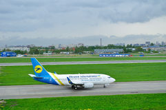 Ukraine International Airlines Boeing 737-500 airplane in Pulkovo International airport in Saint-Petersburg, Russia Royalty Free Stock Photo