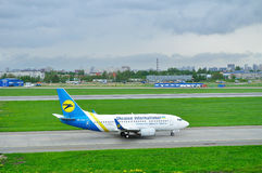 Ukraine International Airlines Boeing 737-500 airplane in Pulkovo International airport in Saint-Petersburg, Russia Royalty Free Stock Photography
