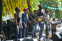 African blues rock music. Ukraine, Ivano-Frankivsk, May 20, 2017: Concert on a free music festival performed by a black African-American rock music band Royalty Free Stock Photo