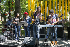 African blues rock music. Ukraine, Ivano-Frankivsk, May 20, 2017: Concert on a free music festival performed by a black African-American rock music band Stock Image