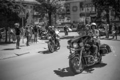 Black and white photos of bikers who are preparing for the parade in honor of opening the season. royalty free stock images