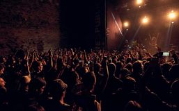 Crowd throwing hands in the air on Respublica rock festival royalty free stock photography