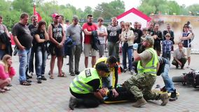 Ukraine, Kanev, June 3, 2017: Master class to provide emergency medical care which is shown on person.Biggest Ukraine stock video