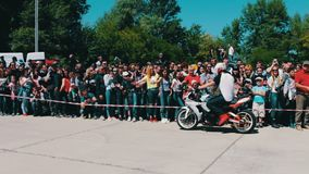 UKRAINE, KANEV, JUNE 3, 2017: Men on sports motorcycles make a show, performing tricks of varying difficulty on stock video