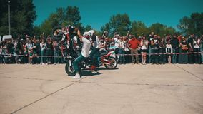 Stunt Moto Show. Moto Rider Rides on the Rear Wheel. Bikers Parade And Show. Slow Motion stock video