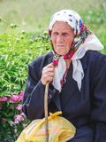 Ukraine. Khmelnitsky region. May 2018.Portrait of an elderly woman with stick in her arms, woman is in trouble_ stock photo