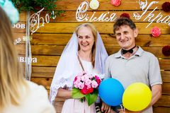Ukraine. Khmelnytsky region. June 2018. An old man and an elderly woman are photographed in clothes of brides on holidays o royalty free stock photography