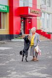 Ukraine. Khmelnytskyi. May 2018. Grandmother hugs her beloved bl royalty free stock photography