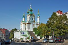 Ukraine. Kiev.  Andreevsky spusk street. Andreevskaya (Saint Andrew's) Church against a background of deep blue sky Stock Images
