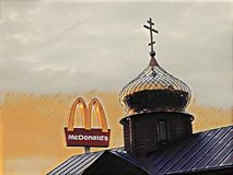 26. 07. 2018. Ukraine. Kiev. Church and McDonald`s. Church and McDonald`s. Church and McDonald`s. The dome of the Orthodox Church on the background of stock illustration
