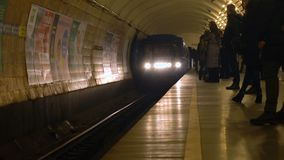 Ukraine, Kiev, Jan 2018: metro train arrive, people loading into, at Lybidska Station. 4k UHD stock video footage