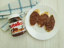 Ukraine Kiev10 March 2018 Nutella nougat nutrition delicious chocolate on the wooden tasty popular creamy lunch. Ukraine Kiev10 March 2018 Nutella hazelnut Royalty Free Stock Photos