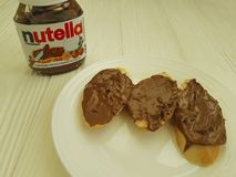 Ukraine Kiev10 March 2018 Nutella nougat  nutrition  delicious chocolate on the wooden tasty popular creamy lunchsandwich. Ukraine Kiev10 March 2018 Nutella Stock Photos