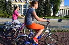 Ukraine, Kiev, May 11, 2015. Two teenage girls ride bicycles.
