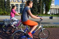 Ukraine, Kiev, May 11, 2015. Two teenage girls ride bicycles.
