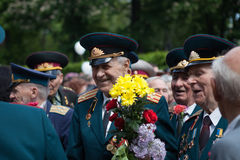 UKRAINE, KIEV, MAY 9, 2016, Victory Day, May 9. Monument to an unknown soldier: Veterans of World War II carry flowers to the monu. Ment of an unknown soldier royalty free stock photos