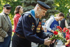 UKRAINE, KIEV, MAY 9, 2016, Victory Day, May 9. Monument to an unknown soldier: Veterans of World War II carry flowers to the monu. Ment of an unknown soldier stock images