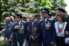UKRAINE, KIEV, MAY 9, 2016, Victory Day, May 9. Monument to an unknown soldier: Veterans of World War II carry flowers to the monu. Ment of an unknown soldier stock photography