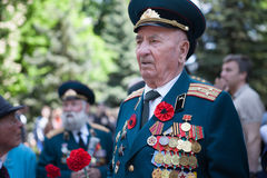 UKRAINE, KIEV, MAY 9, 2016, Victory Day, May 9. Monument to an unknown soldier: Veterans of World War II carry flowers to the monu. Ment of an unknown soldier royalty free stock photo