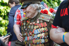 UKRAINE, KIEV, MAY 9, 2016, Victory Day, May 9. Monument to an unknown soldier: Veterans of World War II carry flowers to the monu. Ment of an unknown soldier stock image