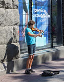 UKRAINE, KIEV - May 27,2013: Young violinist playing on the stre Royalty Free Stock Photo