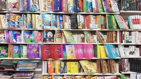 Ukraine, Kiev - October 10, 2019: a store of children`s and adult literature. Showcases on the market with new books. Editorial