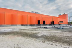 UKRAINE, KIEV. Orange facade of a building under construction. Progress in the construction of shopping mall Republic Royalty Free Stock Images