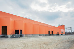 UKRAINE, KIEV. Orange facade of a building under construction. Progress in the construction of shopping mall Republic Stock Photo