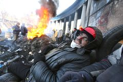 Ukraine. Kiev. Revolutionaries in helmets and masks near flaming tires. stock photography