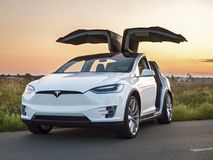 Tesla electric car. Ukraine, Kiev, September 14, 2017: Electric car Tesla on a country road, photo Tesla in the evening at sunset Royalty Free Stock Photos