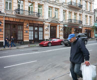 UKRAINE, KIEV - September 9,2013: Expensive supercars and poor s Stock Photos