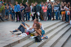 UKRAINE, KIEV - September 11,2013: Homeless couple watching a co Stock Photos