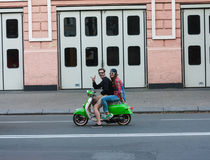 UKRAINE, KIEV - September 9,2013: Man and woman on a motor scoot Royalty Free Stock Photography