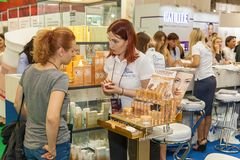 Girl cosmetics consultant. Ukraine Kiev 22 September 2017: Pretty young consultant holds consultation to the buyer Stock Photo
