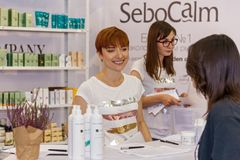 Girl cosmetics consultant. Ukraine Kiev 22 September 2017: Pretty young consultant holds consultation to the buyer Stock Images