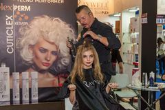 Hairdresser works with a model at the exhibition Stock Images